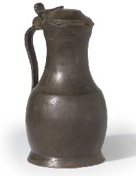 A FLEMISH PEWTER PEAR-SHAPED FLAGON CIRCA 1600 With palmette thumbpiece, the drum decorated with engraved bands, the handle with a scratched indistinct inscription, the inside of base set with a possible medallion high Antique Pewter, Pear Shaped, Tin, Medieval, Auction, Vase, Drum, Antiques, Bands