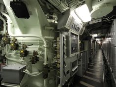 Creepy corridor - On the right are all the computers charged with programming the missiles with directions on how to get to their targets. Along the left are all the missiles. They're blocked off now so you can't walk in and around them.