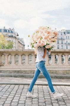 Joyful & Unstoppable a limited edition print of a girl carrying a huge dahlia bouquet in Paris by Carla Coulson