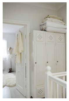 We could build something like this between the bedroom doors on the landing, and it could hold bathroom linens and a little laundry hamper.
