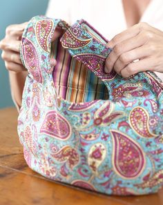 Use a bevy of bright and lively fabrics for this go-everywhere bag. Pockets on the inside are great for holding your phone, keys, and other necessities.