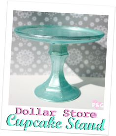 PitterAndGlink: {My Vacation & a Dollar Store Cupcake Stand} with their fav cake on top.