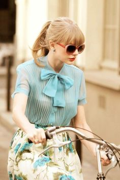 taylor swift style.  Love her :)  Don't care who she dates.
