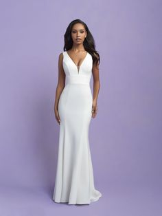 We adore the chic squared-off back and clean lines of this bridal sheath/ fit and flare wedding gown. This gown gives a classic look with a modern twist! Top Wedding Dresses, Wedding Gowns, Bridesmaid Dresses, Bridal Dresses, Allure Romance, Gown Gallery, Bridal Tops, Designer Gowns, Bridal Boutique
