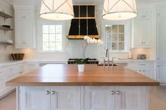 Lighting whose color blends in but still makes a fabulous, bold statement, the right pendant can totally transform a kitchen.