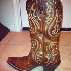 My blinged out cowboy boots!  I did these right around the rodeo time using fabric jewels and the E-6000 industrial strength adhesive (you can find at craft stores).