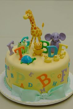 Animal Alphabet Cake - These cute baby animals are just learning to spell. The decorations are all made out of fondant.