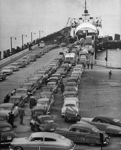 Mackinaw Straits Ferry - Mackinaw, Michigan - 1950  When the Mackinac Bridge opened to traffic on November 1, 1957, car ferry service between Mackinaw City and St. Ignace ended. In 34 years of service, the ferries operated by the Department of State Highways carried approximately 12 million vehicles and more than 30 million passengers across the Straits of Mackinac.