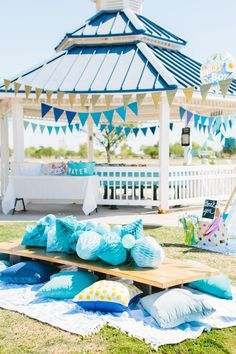 Toddler Table at A first birthday picnic in the park | Momma Society-the community of modern moms | www.MommaSociety.com