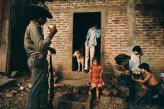 Found in the Magnum Nicaragua Book: Sandistas on daily rounds in Esteli neighborhood, Esteli, Nicaragua, 1981 (Susan Meiselas).