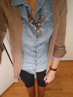 Denim shirt under cardigan with a statement necklace leggings boots..