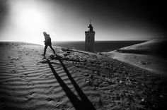 """500px / Photo """"Lighthouse and person in backlight"""" by Michael Johansen"""