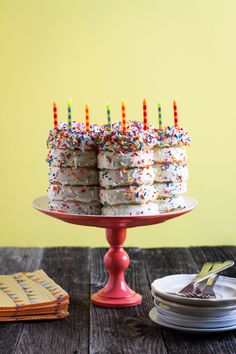 Doughnut birthday cake..... even I can go to Krispie Kreme and put them together like this and then add some sprinkles, genius.