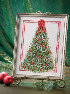 This project will usher in the holidays in any setting.   An elegant Christmas tree demands the spotlight in this beautiful design from Sharon Pope. Stitched in DMC® floss with a sprinkling of metallic sparkle from Kreinik®, this project will usher in the holidays in any setting.