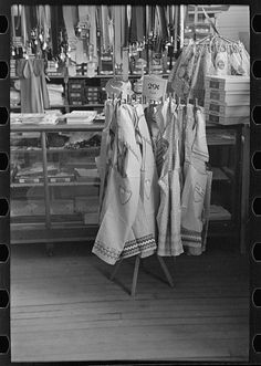 """""""Aprons on display in general store; Ray, North Dakota."""" Photographer: Russell Lee, Date: October 1937   Part of: Farm Security Administration - Office of War Information Photograph Collection (Library of Congress)"""