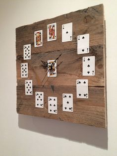 This unique clock has been made from reclaimed pallet wood. The playing cards give the numbers a quirky look. This is a great centre piece for