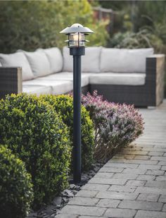 Home Improvement; Outdoor Lighting Ideas The decision to purchase your very own home, is one of the largest investments you will ever make. Outdoor Path Lighting, Outdoor Light Fixtures, Exterior Lighting, Lighting Ideas, Garden Lamp Post, Outdoor Storage Boxes, Potting Tables, Black Garden, Path Lights