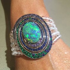 Boucheron Opal bracelet surrounded by emeralds and sapphires