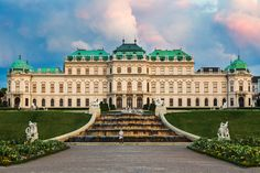 https://flic.kr/p/i4XYPv   The Belvedere   A woman standing in front of the Belvedere Palace gives a sense of the vast scale of the palace. The Belvedere is a historic building complex in Vienna, Austria, consisting of two Baroque palaces (the Upper and Lower Belvedere), the Orangery, and the Palace Stables. The buildings are set in a Baroque park landscape. Jon & Tina Reid   Portfolio   Blog   Tumblr
