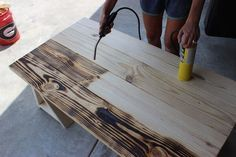 Try burning the wood grain with a torch.: