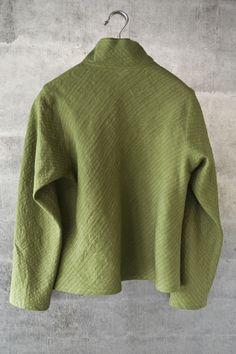Green linen cropped bias jacket.  $1095.