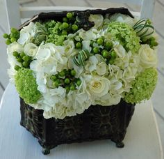 Hydrangea, Hypericum, roses and Ranunculus. I want this for my birthday (but in silk so I can keep it forever)
