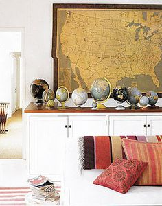 I've always loved this low cabinet with vintage globes and vintage map!