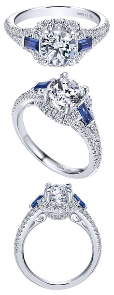 From the Amavida Bridal Collection, an 18k White Gold Contemporary Halo Engagement Ring accented with sapphires.
