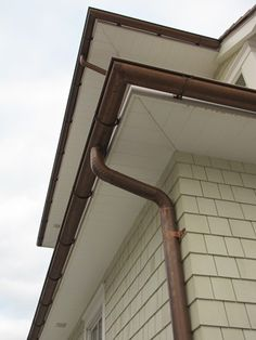 Weathered Copper Rain Gutter And Downspout Water