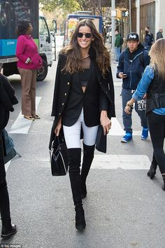 So chic: Izabel Goulart, 31, rocked some black suede boots with white jeans ...