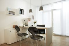perspective consultation room - incorporated existing wire chairs with beautiful custom made linoleum/oak desk and laquered sideboard