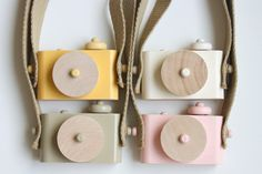 Yaiyee got the green one! Go figure huh?  pixie - wooden toy camera, two-tone w/o cork bottom. $25.00, via Etsy.
