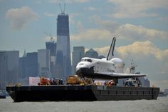 June 6, 2012. I really like this photo from the Time.com photo essay for Space Shuttle Enterprise's move to USS Intrepid, with One World Trade Center in the background.  Freedom Tower became the tallest building in NYC just 5 weeks before on April 30, 2012.  Credit: Time.com, photo by Stan Honda/APP/Getty
