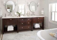 Bathroom ideas, I love the white granite and dark wood.