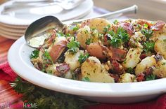 With warm, tender red potatoes and a sweet, tangy dressing loaded with bacon and garlic, this German Potato Salad is a perfect side dish for any occasion, from a grilled dinner to a summer holiday potluck. My kids still have two more weeks of school to go before summer vacation commences, but I understand that some schools across the country have already let out. Well, between that and Memorial Day weekend coming up, I would say that summer grilling season is upon us! And what goes better…