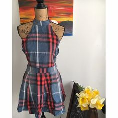 ✨Flash Sale $40✨ NWOT Plaid Low back Dress ✨NWOT & never worn  ✨Bust- 34 inches, waist- 29 inches, and length 32 inches ✨Still selling on Threadsence.com for $69.    Add a little bit of vintage glam to your closet with this black, blue, and red plaid mini dress designed with a high halter-style neckline. Finished with an open back cutout with dual button closures and a hidden back zipper, you'll definitely be sure stand out in this totally rad fit-and-flare dress. Unlined, opaque. By Gab…