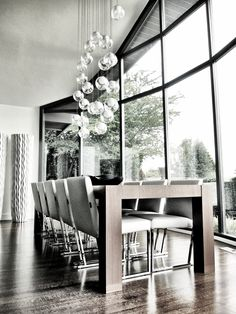 Contemporary Dining Room with Windows & Glass Bubble Chandelier