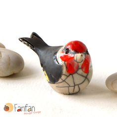 https://www.alittlemarket.com/accessoires-de-maison/fr_joli_chardonneret_en_ceramique_raku_-16058381.html Plus