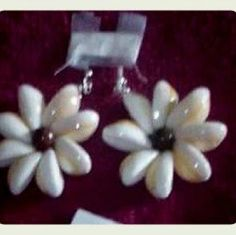 Handmade white cowery earrings Handmade white cowery shell earrings in the shape of a tiare flower Jewelry Earrings