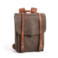 You've never seen a backpack look so sexy. This handmade leather backpack brings a grown up sophistication to a classic style, and you reap all the benefits: tw