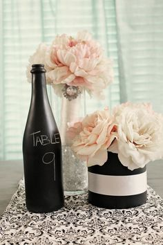CHALKBOARD  wine bottle, $30.00, via Etsy.    Make your own using champagne bottles, add gold glitter around the bottom and a candle for a perfect NYE wedding table number!