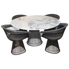 Warren Platner Arabesque Marble Dining Table with Four Chairs   From a unique collection of antique and modern dining room sets at https://www.1stdibs.com/furniture/tables/dining-room-sets/
