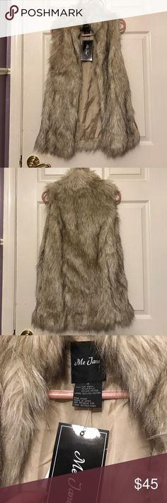 Fur vest Super cute beige fur vest with pockets! On the longer side. I'm 5ft and it's a little too long on me! Me Jane Jackets & Coats Vests