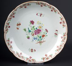 Description A Chinese porcelain saucer dish Painted in famille rose enamels with a ribbon tied flower spray within a foliate and line border  Date 18th century, Qing - Qianlong period (1735-1796)  www.collectorstrade.de