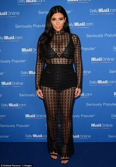 Sticking to her style: Kim Kardashian was a stunning addition to the MailOnline yacht party in Cannes on Wednesday, as she arrived in a sheer black lace-style dress