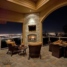 City lights at night are already amazing, but enjoying them from here next to that fireplace...perfection.
