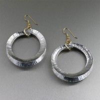 Fold Formed Aluminum Hoop Earrings. Simply Stunning! http://www.johnsbrana.com/fold-formed-aluminum-hoop-earrings.html $85.00
