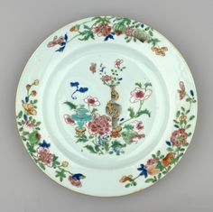 A Chinese famille rose porcelain plate painted at centre w a tall grey & gilt vase w peony sprays besides a squat turquoise incense burner amid a large peony spray, the border w 3 sprays of fruit & flowers.