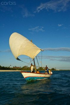 Fishermen sailing a dhow off the coast of Matemo Island, Mozambique.