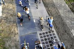 Solaroad in the Netherlands- a stretch of a walkway/bike path integrated with solar cells! Now, France is planning on lining 1000 km with solar technology!